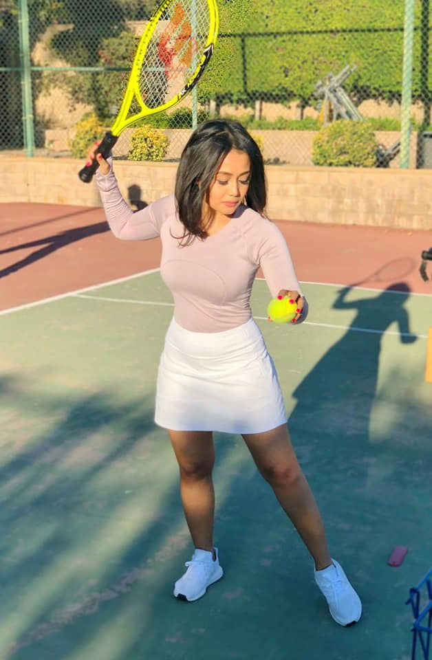 Neha Loves to play Tennis