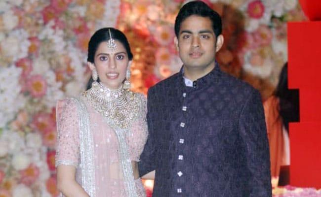 Akash Ambani with his wife Shloka Mehta