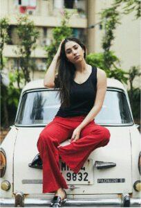 Disha style pose with car