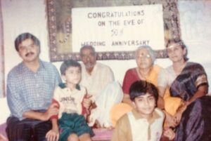 Adarsh sitting on father's lap