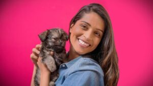 Lilly Singh playing with her Dog