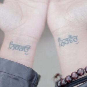 Superwoman's wrists Tattoo